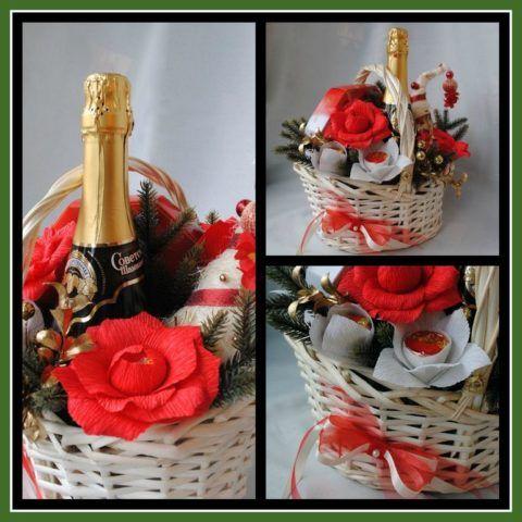 Подарочная корзина с шампанским и конфетами.