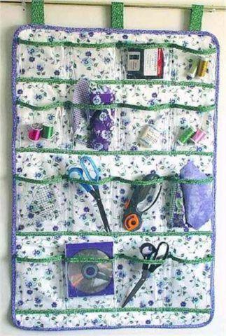 Органайзер из ткани с прозрачными карманами на стену.